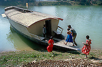 Fourth grade students board the boat school docked on the Atrai river. Each boat functions as a school bus, picking up children along the river, and as a school where classes are held. (Photo by Tadej Znidarcic)