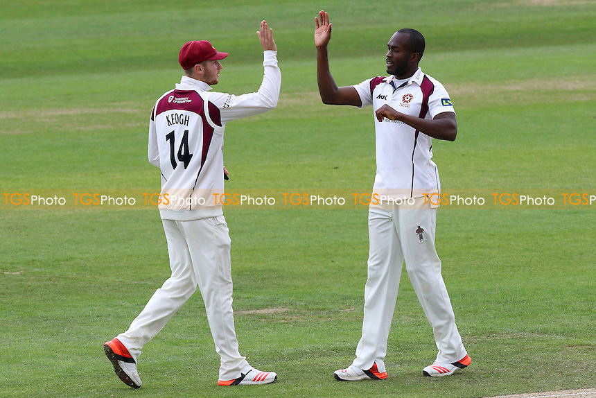 Maurice Chambers (R) of Northamptonshire CCC celebrates taking the wicket of Jesse Ryder