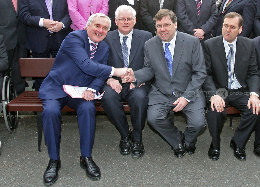 09/04/'08 Tainiste Brian Cowen shakes hands with Taoiseach Bertie Ahern with Seamus Kirk in centre at a photocall with the Fianna Fail Parlimentary Party at Leinster House this morning after Mr. Cowen was elected uncontested leader of Fianna Fail...Picture Collins, Dublin, Colin Keegan.