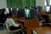 "North Korean watch oversea TV programmes inside the People's Palace of Education, Pyongyang, North Korea. The ""Palace"" is the library and place of learning for privileged North Koreans."