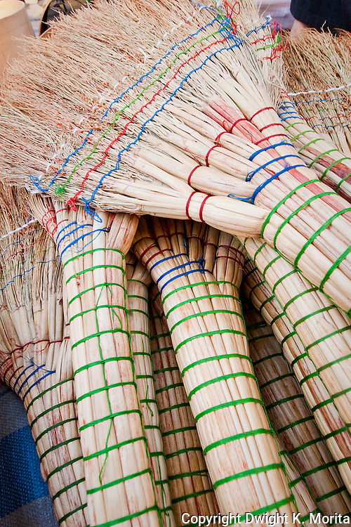 New brooms on display in a market stall found in Wonju, Korea