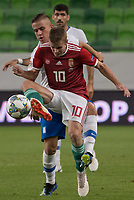 Istvan Kovacs (L) of Hungary and Dimitris Pelkas (R) of Greece fight for the ball during the UEFA Nations' League qualifying match between Hungary and Greece at the Groupama Arena stadium in Budapest, Hungary on Sept. 11, 2018. ATTILA VOLGYI