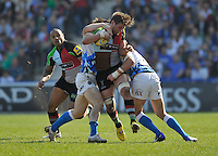London, England. Luke Wallace of Harlequins tackled during the Aviva Premiership match between Harlequins and Bath Rugby at Twickenham Stoop on March 24, 2012 in Twickenham, England.