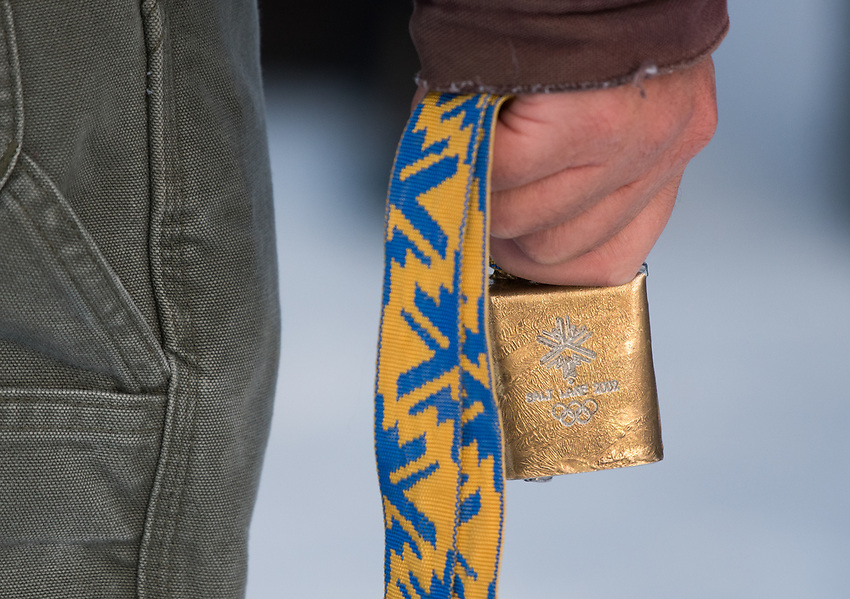 A spectator brandishes a 2002 Salt Lake City Olympics cowbell during the 2018 U.S. National Cross Country Ski Championships at Kincaid Park in Anchorage.