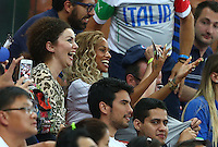 Fanny Neguesha, the fiance of Mario Balotelli of Italy gestures as he blows a kiss to her as he celebrates his winning goal