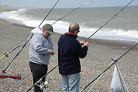 Two men sea fishing at  Weybourne, Norfolk.