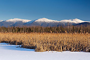 The Presidential Range snow covered from Pondicherry Wildlife Refuge in Jefferson, New Hampshire. This view is from the residential Range Rail Trail (Cohos Trail).