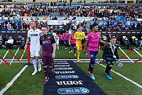Mike van der Hoorn exits the tunnel with child mascot during the Sky Bet Championship match between Swansea City and Queens Park Rangers at the Liberty Stadium, Swansea, Wales, UK. Saturday 29 September 2018