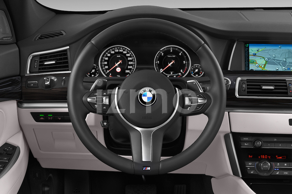 Car pictures of steering wheel view of a2015 BMW SERIES 5 M Sport 2WD AT 5 Door Hatchback 2WD Steering Wheel