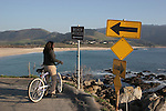 Woman on bike at Carmel River Beach