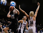SIOUX FALLS, SD: MARCH 19: Maura D'Anna #25 of Indiana (PA) shoots over Stonehill defender Samantha Hyslip #21 during their game at the 2018 Division II Women's Elite 8 Basketball Championship at the Sanford Pentagon in Sioux Falls, S.D. (Photo by Dick Carlson/Inertia)