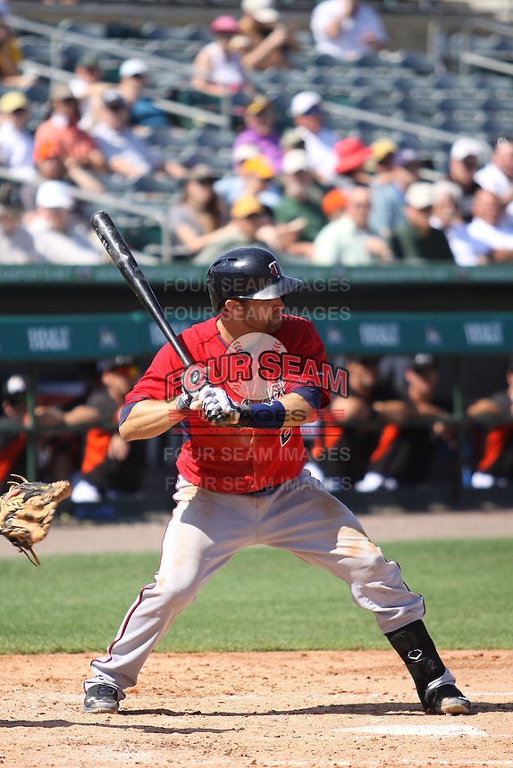 Brian Dozier (2) of the Minnesota Twins at bat during a Grapefruit League Spring Training game at the Roger Dean Complex on March 4, 2014 in Jupiter, Florida. Miami defeated Minnesota 3-1. (Stacy Jo Grant/Four Seam Images)