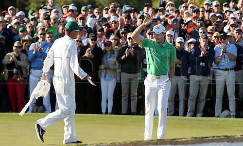 10.04.2016. Augusta, GA, USA.  Danny Willett slaps hands with his caddie Jonathan Smart after finishing 5-under during the final round of the Masters on Sunday, April 10, 2016, at Augusta National Golf Club in Augusta, Ga Willett capatalized on Spieths meltdown on holes 10-12 and won the tournament by 3 strokes on -5.