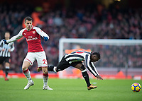 GranitXhaka of Arsenal clashes with Mohamed Diamé of Newcastle United during the Premier League match between Arsenal and Newcastle United at the Emirates Stadium, London, England on 16 December 2017. Photo by Vince  Mignott / PRiME Media Images.