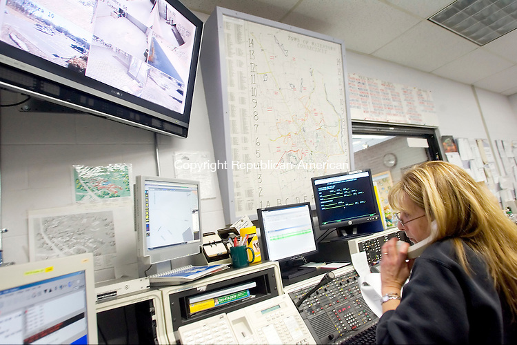 WATERTOWN, CT- 09 MARCH 2008- 030908JT02-<br /> Pat Bessette, a telecommunicator at the Watertown Police Department, takes a call at her job on Sunday afternoon. Bessette and the other Watertown telecommunicators have been given a 3.5 percent raise as part of a newly signed contract. <br /> Josalee Thrift / Republican-American