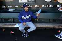 SAN FRANCISCO - AUGUST 1:  Manager Joe Torre #6 of the Los Angeles Dodgers hands a line up card to a coach in the dugout before the game against the San Francisco Giants at AT&T Park on August 1, 2010 in San Francisco, California. Photo by Brad Mangin