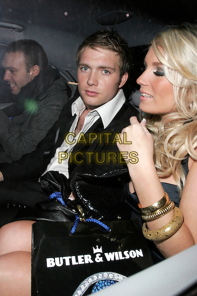 CHRIS FOUNTAIN & GUEST.At Movida nightclub, London, England..October 29th, 2008.half length black suit jacket gold bracelets car thumb.CAP/AH.©Adam Houghton/Capital Pictures.