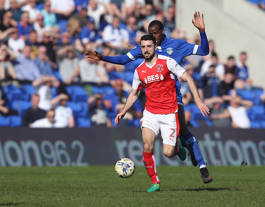 Fleetwood Town's Conor McLaughlin shields the ball from Oldham Athletic's Michael Ngoo<br /> <br /> Photographer Stephen White/CameraSport<br /> <br /> The EFL Sky Bet League One - Oldham Athletic v Fleetwood Town - Saturday 8th April 2017 - SportsDirect.com Park - Oldham<br /> <br /> World Copyright &copy; 2017 CameraSport. All rights reserved. 43 Linden Ave. Countesthorpe. Leicester. England. LE8 5PG - Tel: +44 (0) 116 277 4147 - admin@camerasport.com - www.camerasport.com