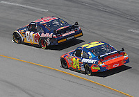 May 6, 2007; Richmond, VA, USA; Nascar Nextel Cup Series driver A.J. Allmendinger (84) leads Jeff Gordon (24) during the Jim Stewart 400 at Richmond International Raceway. Mandatory Credit: Mark J. Rebilas