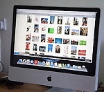 iMac wide screen display of stock photograph thumbnail images of telecommunications, UK content
