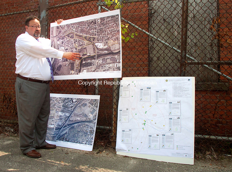 WATERBURY, CT 01 JULY 2015 - 070115DA03- Waterbury Development Corporation Chief Executive Officer Todd M. Montello stands on the site of a 17 acres property off the corner of Benedict and Jewelry streets  discussing to local officials Waterbury brownfields and future plans which has hope of being cleaned up and developed. <br /> Darlene Douty Republican-American
