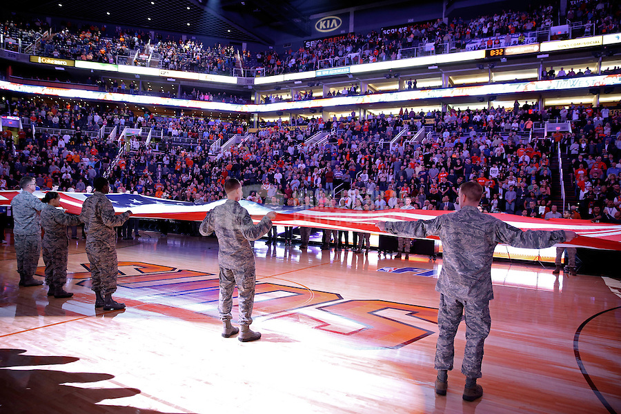 Jan. 24, 2013; Phoenix, AZ, USA: U.S. Air Force military service members hold an American flag during the national anthem prior to the game between the Phoenix Suns against the Los Angeles Clippers at the US Airways Center. The Suns defeated the Clippers 93-88. Mandatory Credit: Mark J. Rebilas-USA TODAY Sports