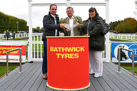 Connections of N over J  receive their trophy from sponsors after winning The Bathwick Car & Van Hire Novice Auction Stakes  during Bathwick Tyres Reduced Admission Race Day at Salisbury Racecourse on 9th October 2017