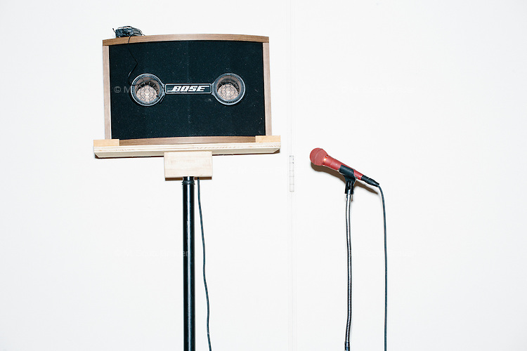 A red microphone stands next to a speaker as Republican presidential candidate Dr. Ben Carson speaks at a town hall campaign stop at a meeting of the Windham Republican Town Committee at the Castleton Banquet and Conference Center in Windham, New Hampshire.