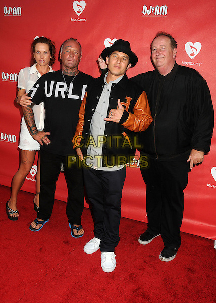 Tracy Adams, Jay Adams, Christian Hosoi, Steve Van Doren<br /> 9th Annual MusiCares MAP Fund Benefit Concert - Arrivals held at Club Nokia, Los Angeles, California, USA, 30th May 2013.<br /> full length black white shirt jacket hand gesture black tattoos on face neck tattoo hat <br /> CAP/ADM/BP<br /> &copy;Byron Purvis/AdMedia/Capital Pictures