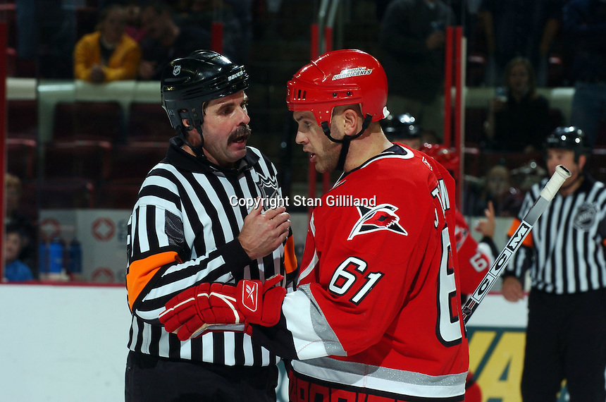 Carolina Hurricanes' Cory Stillman discusses a call with an official during a game with the Tampa Bay Lightning Sunday, Nov. 20, 2005 in Raleigh, NC.  Tampa Bay won 5-2.