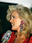 American actress, director, screenwriter and singer Connie Stevens is interviewed as she arrives at the John F. Kennedy Center for the Performing Arts for the Joe Gibbs Charities Gala on June 20, 1989.<br /> Credit: Ron Sachs / CNP