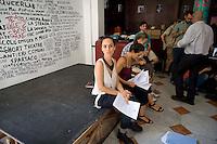Roma 11 Agosto 2014.<br /> Gli occupanti del Teatro Valle nel giorno della riconsegna dello stabile al Comune di Roma.<br /> Conferenza stampa nel foyer del teatro. Ilenia Caleo, attrice, portavoce del Teatro Valle Occupato (C)<br /> Rome August 11, 2014. <br /> The occupants of the Teatro Valle in the day of delivery of the building to the City of Rome. <br /> The press conference in the foyer. Ilenia Caleo, actress, spokesperson for the Teatro Valle Occupied (C)
