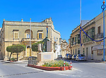 Historic streets in Tarxien area, near Valletta, Malta small square with war memorial sculpture