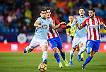 Jonathan Castro Otto, Jonny, (l) of RC Celta de Vigo battles for the ball with Antoine Griezmann (c) of Atletico de Madrid during their La Liga match between Atletico de Madrid and RC Celta de Vigo at the Vicente Calderón Stadium on 12 February 2017 in Madrid, Spain. Photo by Diego Gonzalez Souto / Power Sport Images