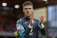 Freddie Woodman of Swansea City thanks away supporters during the Sky Bet Championship match between Barnsley and Swansea City at Oakwell Stadium, Barnsley, England, UK. Saturday 19 October 2019