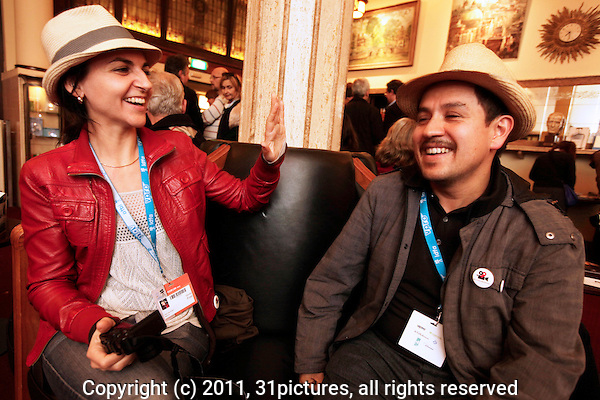 The Netherlands, Amsterdam, 23 November 2011. The International Documentary Film Festival Amsterdam 2011. Guest meet Guests Cinema Chile Drink in Schiller Brasserie. From left; Giulia Fratie, Diego Briceno-Orduz, Cuban Hat. Photo: 31pictures.nl / (c) 2011, www.31pictures.nl