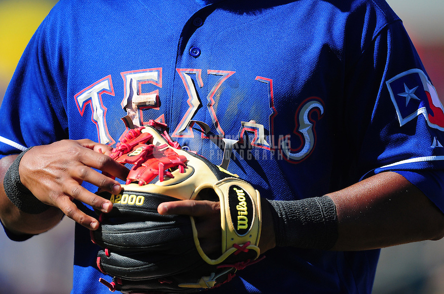 Mar. 15, 2012; Surprise, AZ, USA; Detailed view of the Texas Rangers logo falling off the shirt of shortstop Elvis Andrus in the fifth inning against the Oakland Athletics at Surprise Stadium.  Mandatory Credit: Mark J. Rebilas-