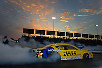Sept. 28, 2012; Madison, IL, USA: NHRA pro stock driver Jeg Coughlin during qualifying for the Midwest Nationals at Gateway Motorsports Park. Mandatory Credit: Mark J. Rebilas-