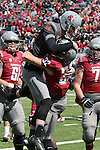 Cougar quarterback, Connor Halliday (#12), and receiver, Drew Loftus (#32), celebrate a touchdown pass at the annual Washington State Cougar spring game, the Crimson and Gray game, at Joe Albi Stadium in Spokane, Washington, on April 26, 2014.
