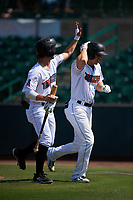 Inland Empire 66ers first baseman Jordan Zimmerman (5) is congratulated by Jonah Todd (7) after hitting a home run during a California League game against the Lancaster JetHawks at San Manuel Stadium on May 20, 2018 in San Bernardino, California. Inland Empire defeated Lancaster 12-2. (Zachary Lucy/Four Seam Images)