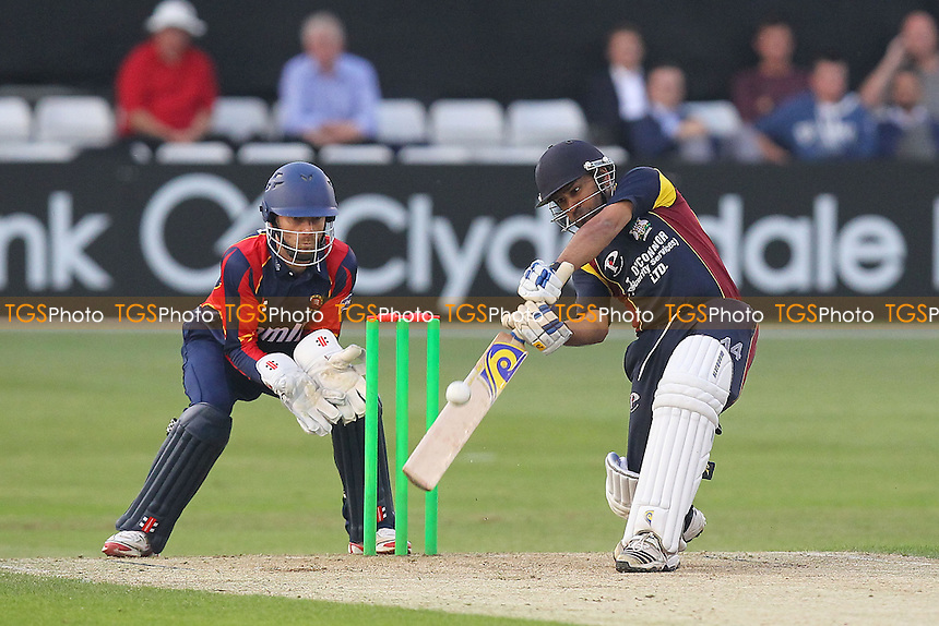Arfan Akram hits out for the Essex League XI as James Foster looks on - Essex Eagles vs Shepherd Neame Essex League XI - Twenty 20 T20 Cricket Friendly at the Essex County Ground, Chelmsford - 18/06/13 - MANDATORY CREDIT: Gavin Ellis/TGSPHOTO - Self billing applies where appropriate - 0845 094 6026 - contact@tgsphoto.co.uk - NO UNPAID USE