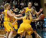 SIOUX FALLS, SD: FEBRUARY 28: Sam Knecht #50 from the University of Sioux Falls looks for help out of a triple team including Jill Conrad #40 and Paige Waytashek #10 from Northern State University in the Women's NSIC Championship Game at the Sanford Pentagon. (Photo by Dave Eggen/Inertia)