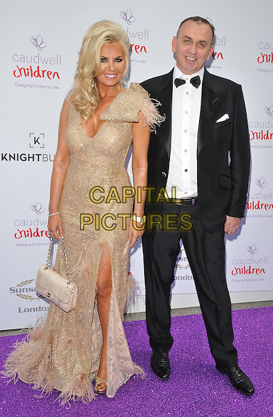 Claire Johnson &amp; guest at the Caudwell Children Butterfly Ball, Grosvenor House Hotel, Park Lane, London, England, UK, on Wednesday 22 June 2016.<br /> CAP/CAN<br /> &copy;CAN/Capital Pictures