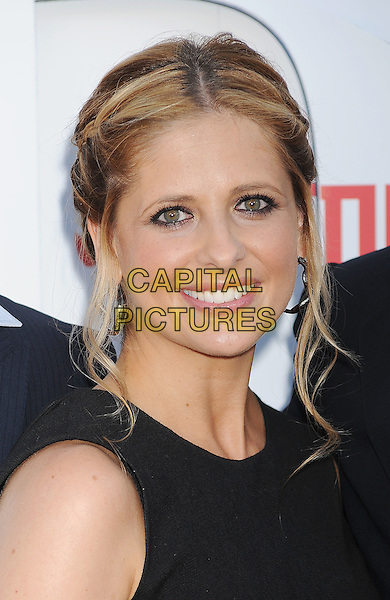Sarah Michelle Gellar.CBS, CW and Showtime Summer 2011 TCA Party held at The Pagoda, Beverly Hills, California, USA..August 3rd, 2011.headshot portrait black silver hoop earrings smiling.CAP/ROT/TM.©Tony Michaels/Roth Stock/Capital Pictures