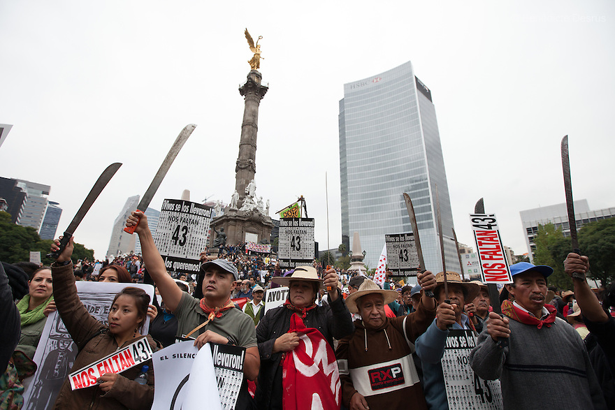 Thousands of people march to mark the one-year anniversary of the disappearance of the 43 students from Mexico's Ayotzinapa College Raul Isidro Burgos, in Mexico City, Mexico on September 26, 2015. Families of the missing and international experts cast doubt on Mexican government's official account of the incident: that municipal police handed the students over to a local drug gang who burned their bodies in a nearby garbage dump. The families asked the government to launch a new internationally supervised investigation and to review Mexico's own investigators. More than 25,000 people have disappeared in Mexico since 2007, according to the government. (Photo by BénédicteDesrus)