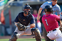 Mobile BayBears catcher Jack Kruger (10) looks to tag Ben Rortvedt (1) sliding home during a Southern League game against the Mobile BayBears on July 25, 2019 at Blue Wahoos Stadium in Pensacola, Florida.  Pensacola defeated Mobile 2-1 in the first game of a doubleheader.  (Mike Janes/Four Seam Images)