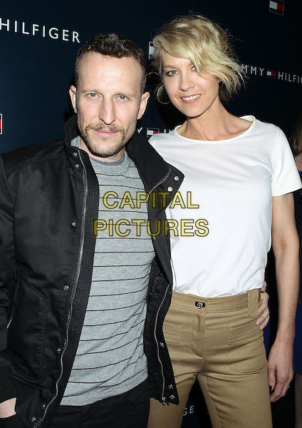 Bodhi Elfman, Jenna Elfman.Tommy Hilfiger West Coast Flagship Grand Opening Event, West Hollywood, California, USA, .13th February 2013 ..half length white top beige trousers black jacket smiling .CAP/ADM/RE.©Russ Elliot/AdMedia/Capital Pictures.