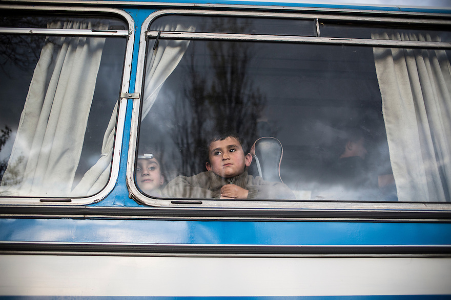 Asylum seekers arrive by bus to Voenna Rampa camp in Sofia, Bulgaria. There, hundreds of people had been made to wait many months for their cases to be decided and to receive their documents. In the meantime the children receive no formal education, conditions are poor and resources are slim.