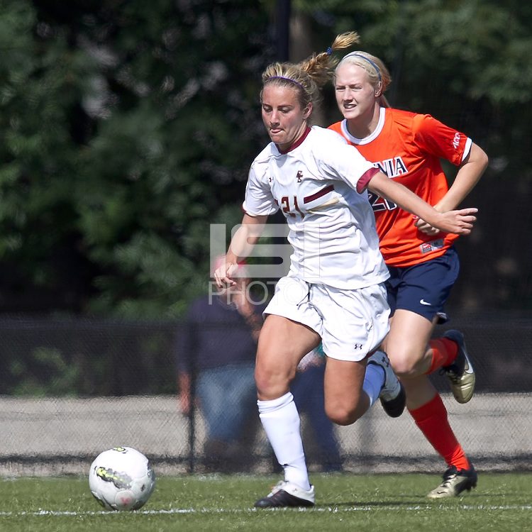 Boston College forward/midfielder Kate McCarthy (21) brings the ball forward as University of Virginia forward Mary Morgan (21) closes. Boston College defeated University of Virginia, 2-0, at the Newton Soccer Field, on September 18, 2011.