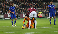 Cardiff City's Neil Etheridge is in pain after colliding with West Ham United's Angelo Ogbonna<br /> <br /> Photographer Rob Newell/CameraSport<br /> <br /> The Premier League - West Ham United v Cardiff City - Tuesday 4th December 2018 - London Stadium - London<br /> <br /> World Copyright © 2018 CameraSport. All rights reserved. 43 Linden Ave. Countesthorpe. Leicester. England. LE8 5PG - Tel: +44 (0) 116 277 4147 - admin@camerasport.com - www.camerasport.com